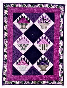 "I still love the look of this little purple basket quilt, which measures 23"" X 30"".  The design for this little quilt comes from Gai Perry's book, ""Color from the Heart,"" one of my favorite quilting books, one which I have used and reused over the years."