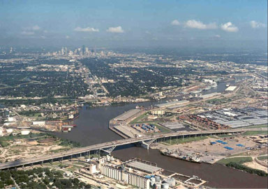 The Port of Houston Turning Basin near the 610 Loop Bridge that crosses the Channel.  Beyond the basin, the ship channel becomes more of its original self--Buffalo Bayou with downtown Houston in the background.