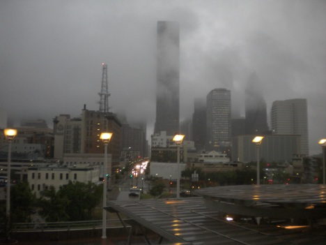 Downtown Houston enshrouded in rain and clouds.