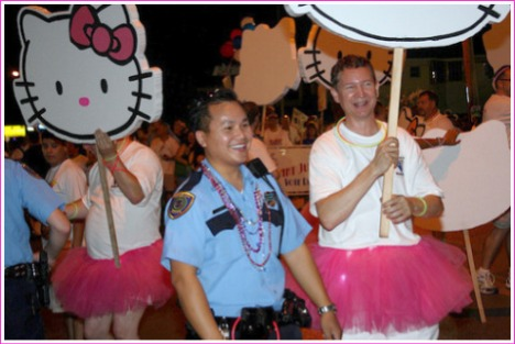"""HPD officer enjoying himself big time with the """"Hello Kitty"""" Brigade"""