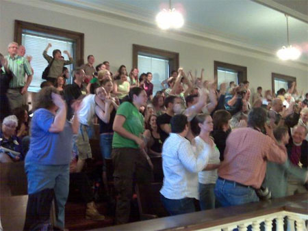 Supporters of marriage equality celebrate after the bill passes in the New Hampshire House.  Among those in the group is the Rev. Gene Robison, Episcopal Bishop of New Hampshire, who can be seen at the lower left.