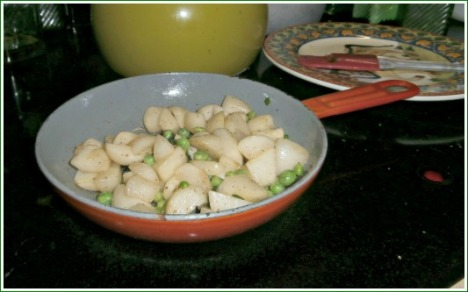 Green peas and turnips sautéed with some bits of green onion, all fresh from the garden, make for a delicious veggie dish for supper.