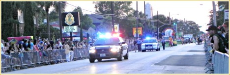 As the crowds of spectators await, HPD heads down Westheimer, leading of Pride Parade 2013.
