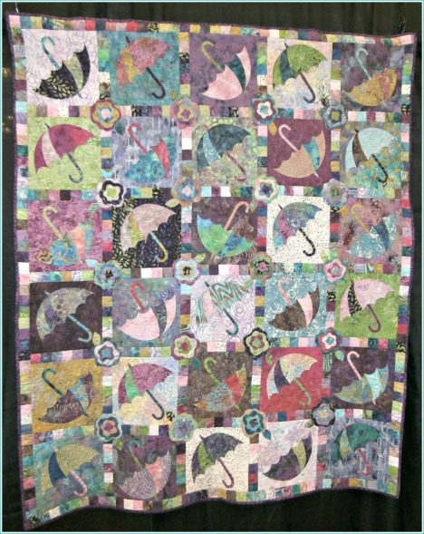 Colorful and detailed umbrella quilt.