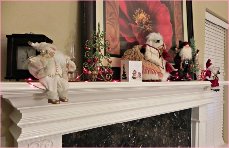 The mantle is fiilled with Santas and other shiny treasures.