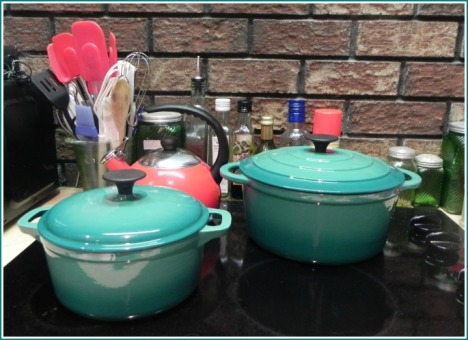 These bright Cocinaware pots purchased at HEB should be fun and easier to use than covering baking dishes with aluminum foil.